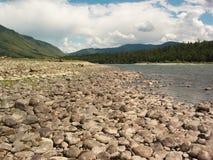 Stony river. Altay. Stony mountain river bank Royalty Free Stock Photography