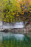 Stony riverbank in autumn. Colourfull picture Royalty Free Stock Photo