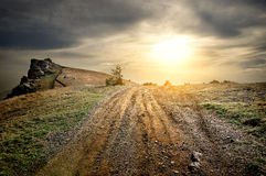 Stony road in mountains Stock Image