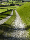 Stony route. Small stony route in rural. In background green field Royalty Free Stock Photography
