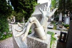 Stony sculpture hands on Vlasta Burian grave in Vysehrad cemetery in Prague, Czech Republic Stock Photos