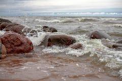 The stony sea coast in windy weather Royalty Free Stock Photo