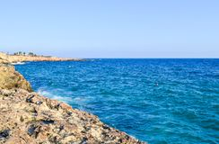 Stony sea shore on a sunny day. Cyprus royalty free stock images