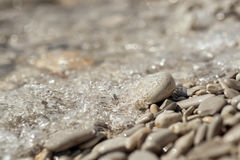 Stony seaboard with soft focus Stock Image