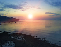 Stony seacoast and mountains on a sunset. Indonesia. Bali Royalty Free Stock Image