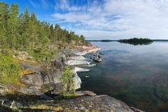 Stony shore of Ladoga lake Stock Photos
