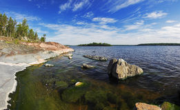 Stony shore of Ladoga lake Royalty Free Stock Photos
