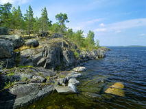 Stony shore of Ladoga lake Royalty Free Stock Photo