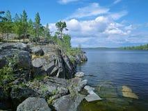 Stony shore of Ladoga lake. Karelia, Russia Royalty Free Stock Images