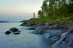 Stony shore of Ladoga lake at whiht night, Russia Royalty Free Stock Image