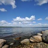 Stony shore of lake Stock Photo