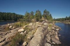 Stony shore of the lake Stock Photo