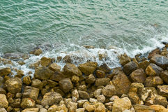 Stony shore sea waves Royalty Free Stock Images