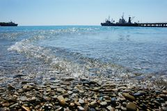 Stony shore and ship at the pier Royalty Free Stock Images