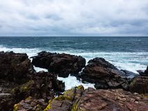 Stony shore in windy weather. stock images