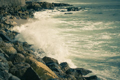The stony shores of the Atlantic Ocean. Portugal. Toned Royalty Free Stock Images