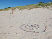 The stony spiral on the beach. The artificial stony spiral on the sand beach on the Baltic Sea, Curonian Spit, Russia Stock Photography