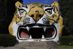 Stony Tiger Head. As an attraction for children and as a symbol of the chinese Yi minority which worships the tiger Royalty Free Stock Photos