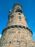 stony tower  on the peak of rocky hill. Early morning sunshine, blue sky, dry  stony walls. Royalty Free Stock Image