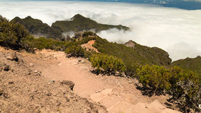 Stony track in the mountains of Madeira over clouds Royalty Free Stock Photography