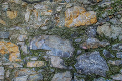 Stony wall with colorful rocks texture background. Stock Image