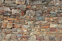 A stony wall was set up in a park (France) Royalty Free Stock Photos