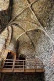 Stony walls interior of the castle with wooden bridge