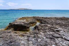Stony waterside on Kamenjak peninsula, Adriatic Sea, Premantura, Croatia. Stony waterside on Kamenjak peninsula by the Adriatic Sea in Premantura, Croatia royalty free stock image