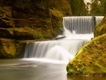 Free Stony  Weir On Small Mountain River. Stream Is Flowing Over Blocks And Makes Milky Water. Stock Images - 55293654