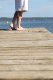 Stood on jetty looking out Stock Images