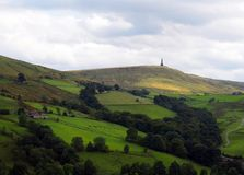 Stoodley pike monument in west yorkshire landscape. With upland farms and moors in the distance royalty free stock photo