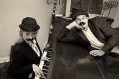 Stooges op piano Stock Afbeeldingen