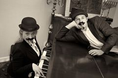 Stooges on piano. A comedy duo or stooges on a piano Stock Images