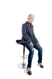 Stool. Short Blond Haired Woman Sat On A Bar Stool Stock Photography