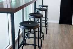Stool in front of counter bar at coffee shop. Black stool Royalty Free Stock Image