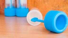 Stool sample jars with transport medium. Used in laboratory medicine Stock Image