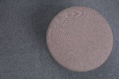Stool sitting on gray floor. Royalty Free Stock Photo