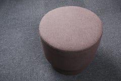 Stool sitting on gray floor. Royalty Free Stock Image