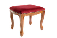 Stool in velvet. And wood in front of white background Stock Image