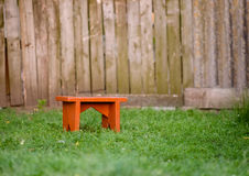 Stool in a yard Stock Images
