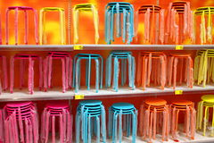Stools. Colored chairs design placed on shelves in shop.Stools Stock Photos
