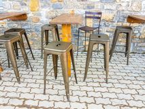 Stools and a wooden table on the outside of a bar prepared to sit for a drink. Seat furniture chair bench chrome shape business elegant model decor tall royalty free stock photos