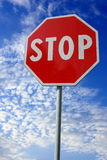 Stop. Red stop sign over cloudy blue sky Royalty Free Stock Images