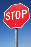 STOP. Sign against blue Royalty Free Stock Photography