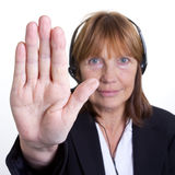 Stop. Older senior business woman's arthritic hand with knobbly fingers in a stop talk to the hand gesture Stock Image