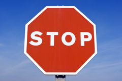 Stop. Traffic sign on blue sky background Stock Images