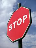 Stop. Signal against a cloudy sky Royalty Free Stock Photography