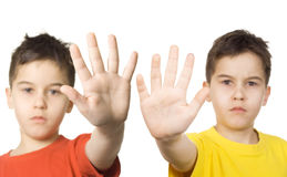 Stop!. Boys with their hands straight out royalty free stock photo
