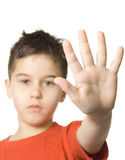 Stop!. Boy with his hand straight out - isolated royalty free stock photo