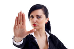 Stop!. Serious businesswoman making stop sign over white, focus on hand Stock Images